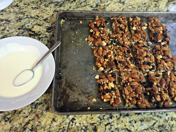 Melt the white chocolate and oil together and drizzle over cooled bars.