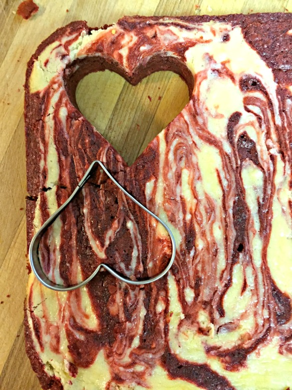Use a heart-shaped cookie cutter to cut out hearts from the brownies.