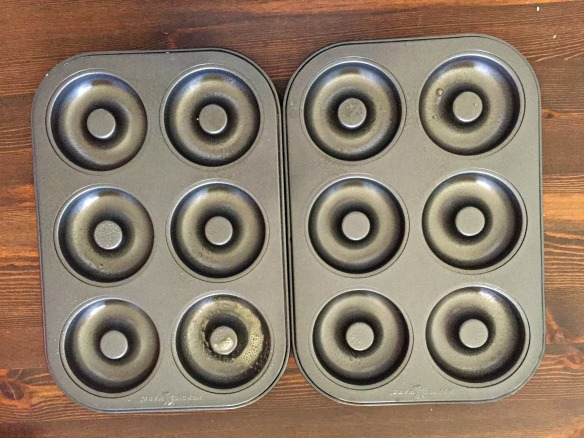 Preheat oven to 350 degrees. Spray donut pans with nonstick cooking spray and set aside.