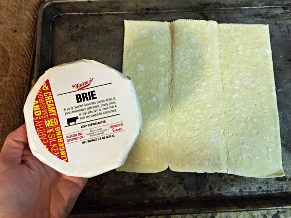 Roll out puff pastry on a greased baking sheet. It's brie time!