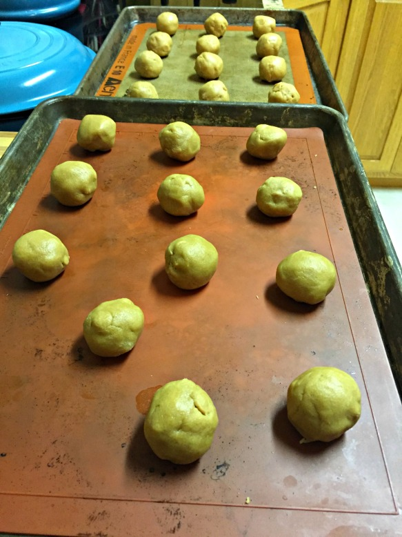 Scoop out balls of dough and place on lined baking sheets.