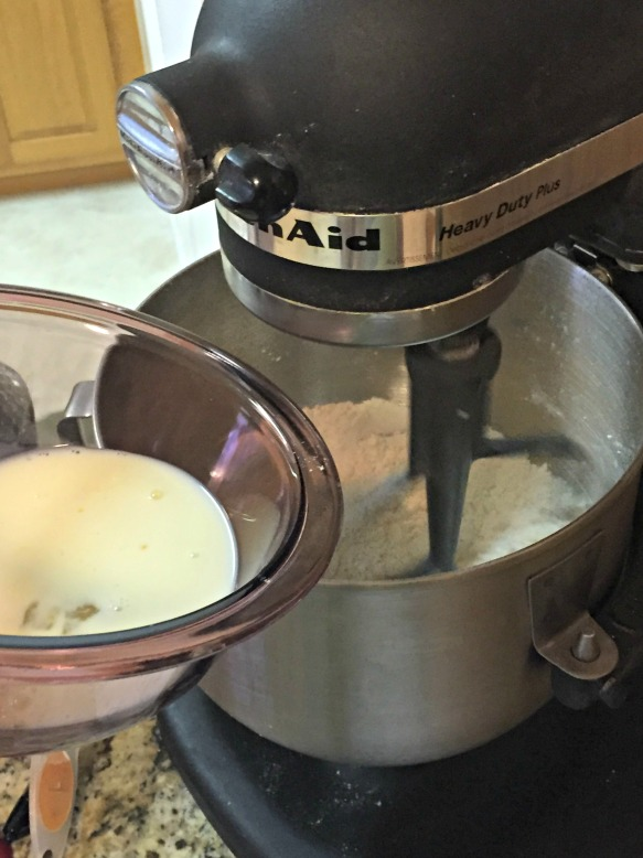 With the mixer on low, slowly pour in the milk mixture.
