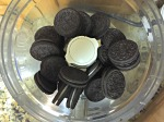 Put Oreos in the bowl of a food processor.