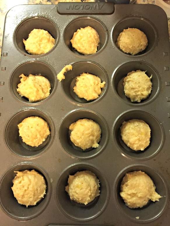 Scoop a bit of batter into the bottoms of the muffin pan.
