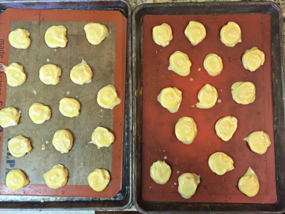 Brush tops with egg wash. Bake at 375 degrees for about 30 minutes, rotating pans halfway through. The tops should be golden. Remove from oven and place pans on wire cooling racks.