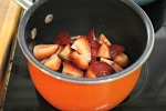 Add sliced strawberries to a saucepan and heat over medium heat for a few minutes, stirring occasionally.