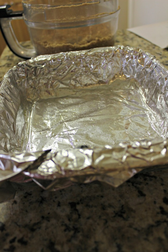 "Line an 8x8"" baking pan with foil and spray with cooking spray. Press the crust evenly into the bottom."