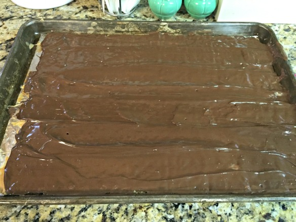 Remove from oven and spread the chocolate evenly with a spatula.