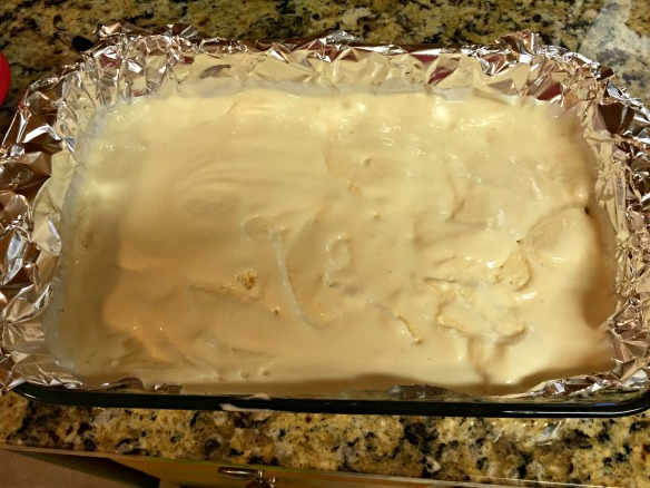 Spread softened ice cream in a foil-lined baking dish. Refreeze for at least two hours.