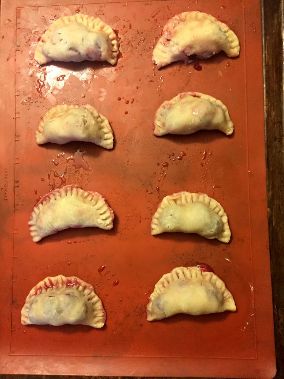 Carefully fold over each circle and seal with the tines of a fork. Do your best to seal them completely, but don't sweat it if you can't get them perfectly sealed. I had plenty of juice spill out of the pies while they were baking...no big deal. Bake at 425 degrees for 15 minutes.